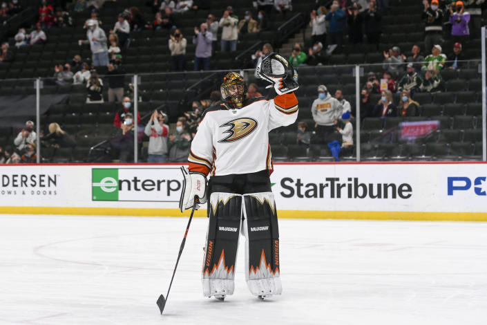 Anaheim Ducks goalie Ryan Miller waves to the crowd during a standing ovation after it was announced that this would be his last NHL hockey game, against the Minnesota Wild on Saturday, May 8, 2021, in St. Paul, Minn. (AP Photo/Craig Lassig)