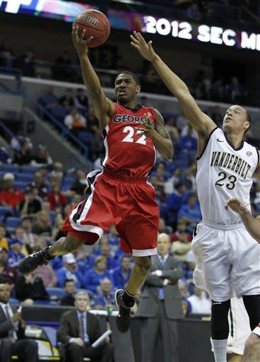 Georgia guard Gerald Robinson (22) shoots against Vanderbilt guard John Jenkins (23) during the first half of an NCAA college basketball game in the second round of the Southeastern Conference tournament at the New Orleans Arena in New Orleans, Friday, March 9, 2012. (AP Photo/Bill Haber)