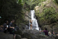 """Candice Swanepoel admitted that there's something about the elements that makes her feel sexy. """"I like to live in my bikini,"""" she admitted. """"It's almost like I'm wearing nothing."""" The rocks at the waterfall were slippery but she said that she likes and makes her feel challenged."""