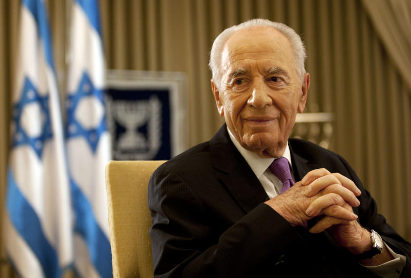 "Israel's President Shimon Peres, during an interview with the Associated Press in his residence in Jerusalem, Thursday, June 16 , 2011. Israeli President Shimon Peres urged a resumption of Middle East peace talks Thursday, dismissing the Palestinians' plan to instead ask the United Nations for recognition as ""an illusion"" and arguing that a peace deal, despite widespread skepticism on both sides was possible within months.  ""In a strange way the differences are rather psychological than material,"" the 87-year-old head of state and Nobel laureate said in an interview with The Associated Press. (AP Photo/Sebastian Scheiner)"