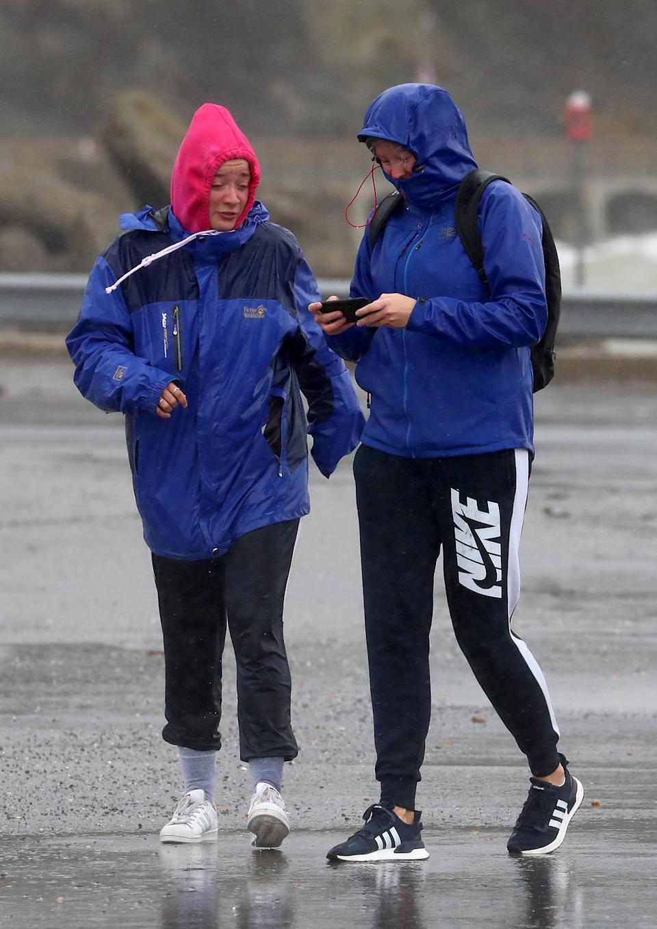 Two girls walk in the bad weather in Folkestone, Kent. Parts of the UK are preparing to be lashed by heavy rain and high winds as Storm Alex heralds the arrival of a stretch of bad weather over the weekend.