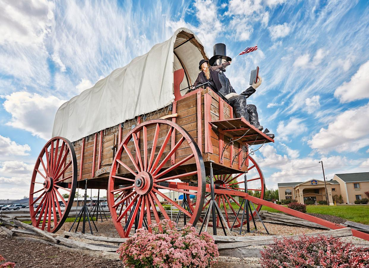 The world's largest covered wagon measures 40 feet long, 12 feet wide and 25 feet tall. David Bentley built the wagon by hand out of Illinois oak and steel in 2001.The wagon now sits near Route 66 inLincoln, Illinois.