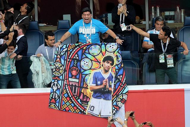 Diego Maradona holds a banner of himself in the stands before the FIFA World Cup Group D match at Saint Petersburg Stadium. Picture date: Tuesday June 26, 2018. (Getty Images)