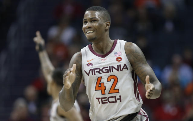 Virginia Tech's Ty Outlaw (42) celebrates after making a basket against Miami during the first half of an NCAA college basketball game in the Atlantic Coast Conference tournament in Charlotte, N.C., Wednesday, March 13, 2019. (AP Photo/Nell Redmond)