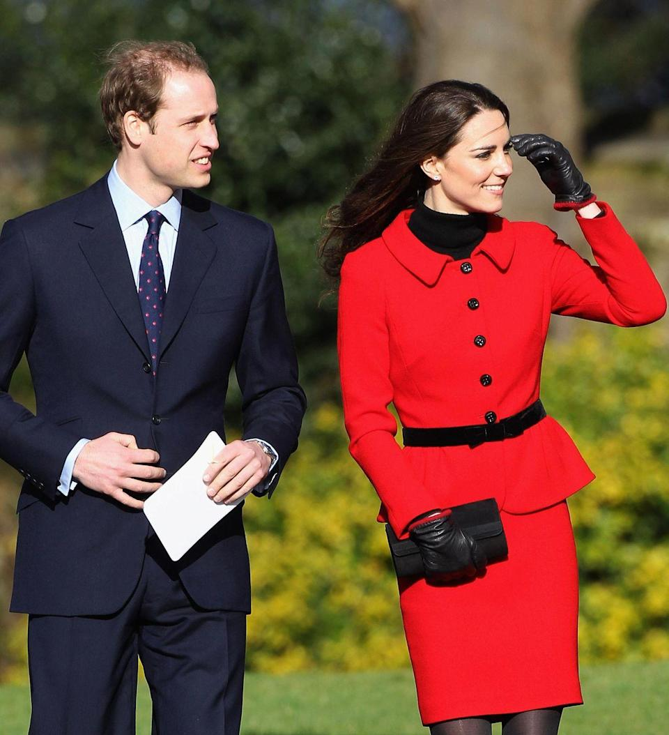 <p>Newly engaged, the royal couple returned to their alma mater, St. Andrews in Scotland, for a fundraising event two months before their wedding. Kate wore a red jacket and skirt from Luisa Spagnoli. </p>