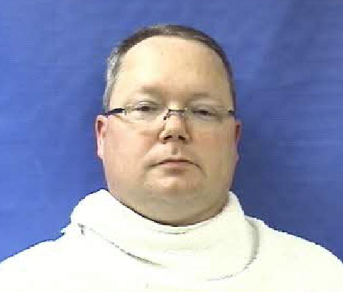 """This photo provided by the Kaufman County Sheriff's Office shows Eric Williams. Williams was admitted to the Kaufman County Jail, in Kaufman, Texas, early Saturday, April 13, 2013, and charged with making a """"terroristic threat."""" Federal and local authorities searched Williams' home Friday as part of an investigation into the deaths of District Attorney Mike McLelland and his wife, Cynthia. (AP Photo/Kaufman County Sheriff's Office)"""