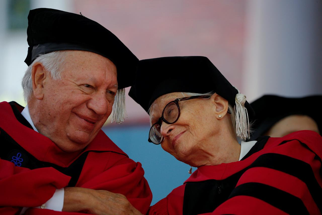 Former President of Chile Ricardo Lagos and choreographer Twyla Tharp congratulate each other after receiving honorary degrees during the 367th Commencement Exercises at Harvard University in Cambridge, Massachusetts, U.S., May 24, 2018.   REUTERS/Brian Snyder