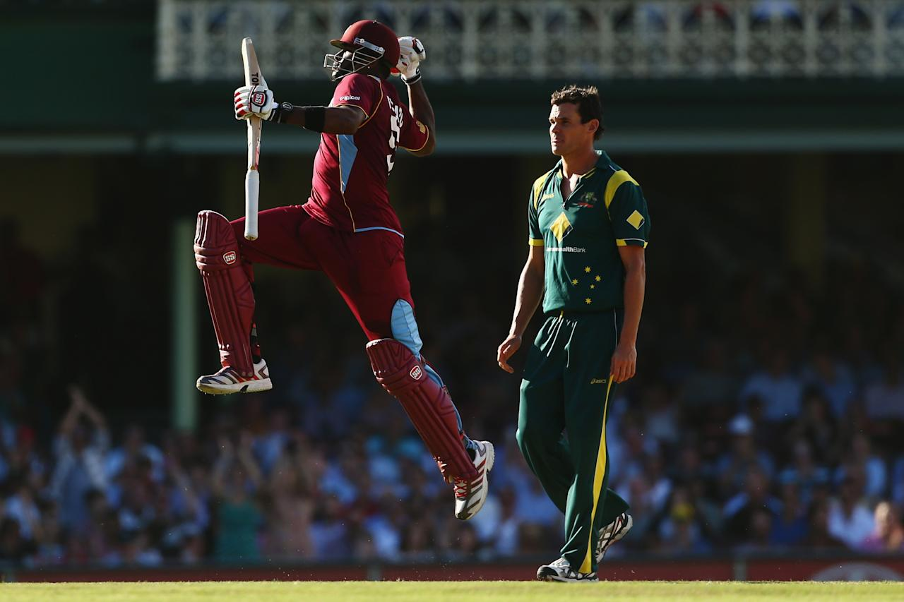 SYDNEY, AUSTRALIA - FEBRUARY 08:  Kieron Pollard of West Indies celebrates scoring his century during game four of the Commonwealth Bank One Day International Series between Australia and the West Indies at Sydney Cricket Ground on February 8, 2013 in Sydney, Australia.  (Photo by Mark Kolbe/Getty Images)