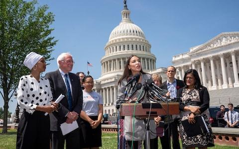 """Alexandria Ocasio-Cortez has drawn criticism for comparing the border detention facilities to """"concentration camps"""" - Credit: AP"""
