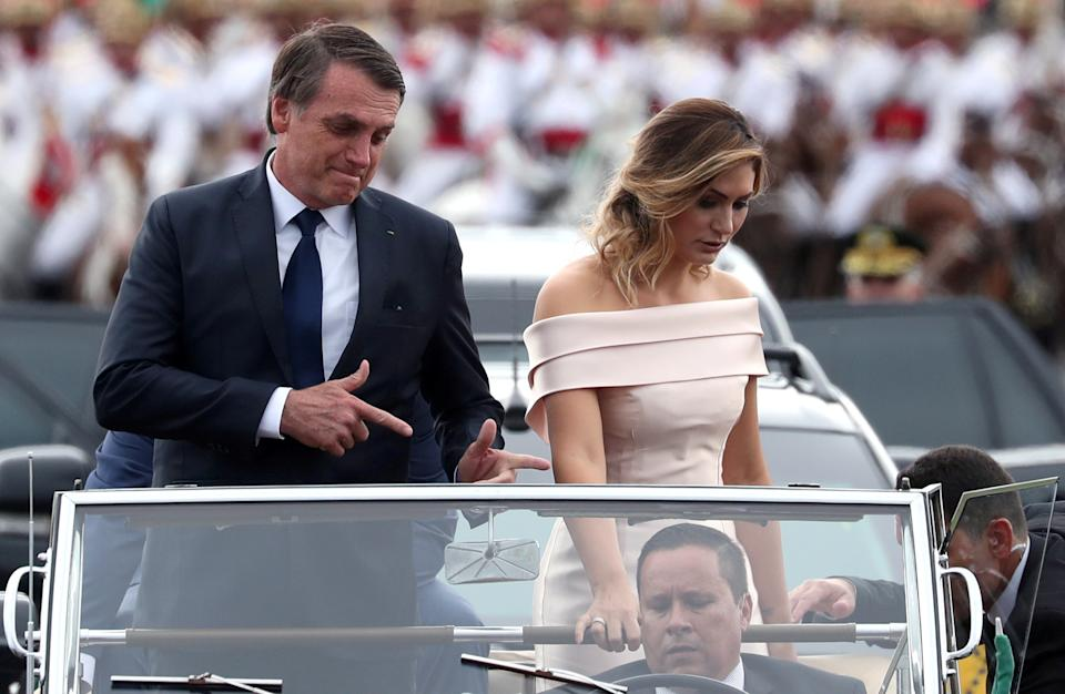 Brazil's new President Jair Bolsonaro gestures as he drives past before his swearing-in ceremony, in Brasilia, Brazil January 1, 2019. REUTERS/Ricardo Moraes TPX IMAGES OF THE DAY