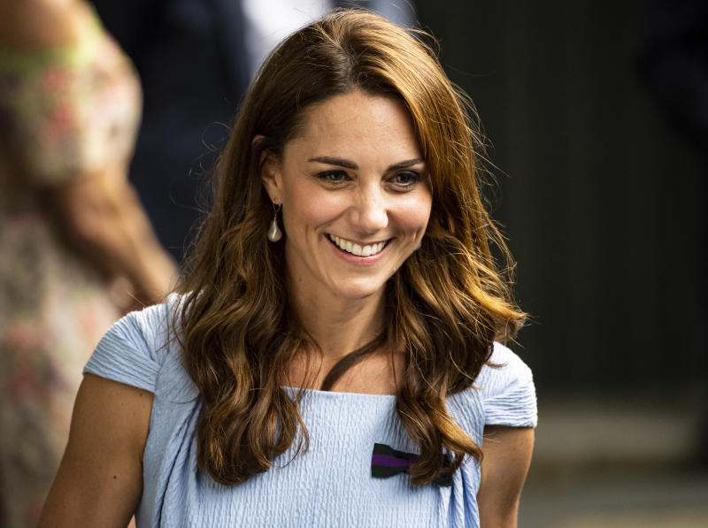 LONDON, ENGLAND - JULY 14: The Duchess of Cambridge leaves Centre Court after the trophy presentation after Novak Djokovic of Serbia's victory over Roger Federer of Switzerland during Day 13 of The Championships - Wimbledon 2019 at All England Lawn Tennis and Croquet Club on July 14, 2019 in London, England. (Photo by TPN/Getty Images)