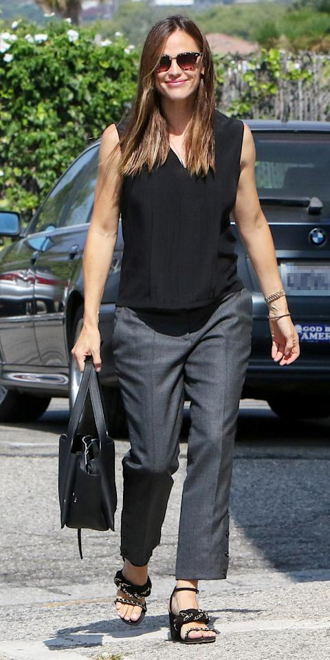 """<p>Garner went to church on Sunday in a modest yet chic ensemble of a loose V-neck tank, gray trousers, and black sandals with chain-link detailing (shop a similar look <a rel=""""nofollow"""" href=""""http://www.barneys.com/product/barneys-new-york-chain-embellished-leather-sandals-505221194.html"""">here</a>). The mother of three accessorized with a sleek black shoulder bag and tortoiseshell sunglasses.</p>"""