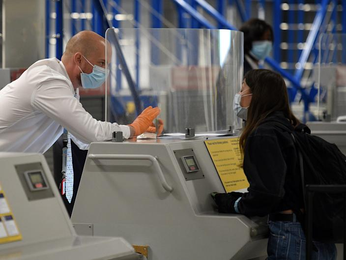 How good are safety screens at protecting us from Covid? (AFP via Getty Images)