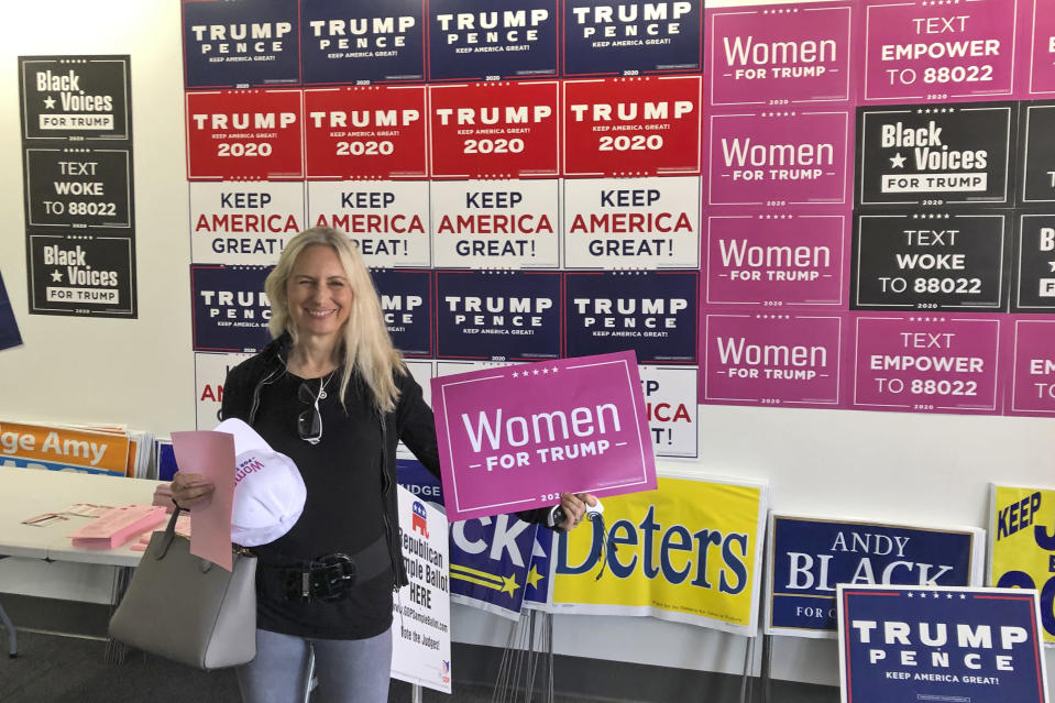 Yana Duke, a suburban voter in the Cincinnati area, turned out for a rally at a Trump-Pence campaign office on the first day of early voting in Ohio, on Tuesday, Oct. 6, 2020. The Donald Trump supporter says this is the first time she's been an active volunteer in a presidential campaign. (AP Photo/Dan Sewell)