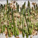 <p>In this garlic-Parmesan-crusted asparagus recipe, we combine Parmesan cheese, whole-wheat panko breadcrumbs and walnuts for a crispy topping that's baked over asparagus. Roasting the asparagus spears in a hot oven keeps them tender-crisp in this quick side dish!</p>