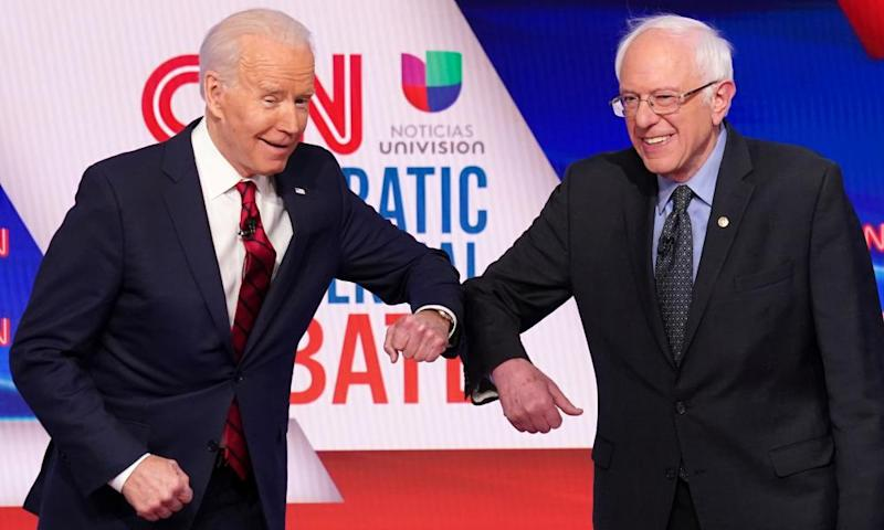 Democratic US presidential candidates Senator Bernie Sanders and former vice-president Joe Biden at the 11th Democratic candidates debate in Washington on 15 March.