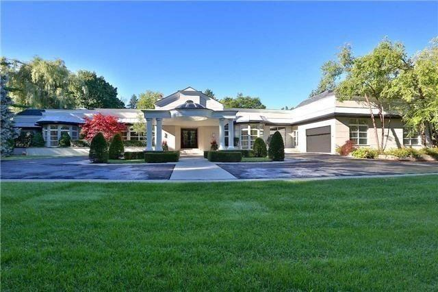 The bungalow is 14,280 square feet and has a 7-car garage.
