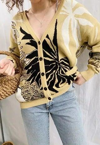 """<br><br><strong>ASOS, ASOS Marketplace</strong> Knit Cardigan Sweater, $, available at <a href=""""https://marketplace.asos.com/listing/cardigans/vintage-80s-escada-tropical-boheme-knit-cardigan-sweater/5910307?queryID=aacbcfcb8a15ddfe0372696171d0613e&index=Products&objectID=5910307&fromSearchTerm=cardigan"""" rel=""""nofollow noopener"""" target=""""_blank"""" data-ylk=""""slk:ASOS, asos marketplace"""" class=""""link rapid-noclick-resp"""">ASOS, asos marketplace</a>"""