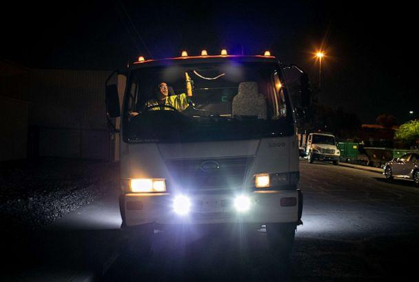 PHOTO: Hector Medrano starts his shift driving a street sweeping truck on Oct. 08, 2020 in Phoenix. This summer Medrano's work as a truck driver was sporadic due to the pandemic. (John Moore/Getty Images)