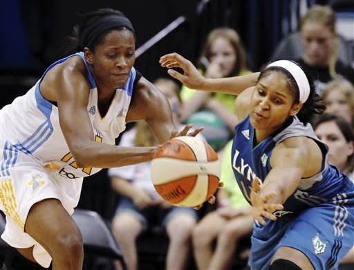 Chicago Sky forward Swin Cash, left, and Minnesota Lynx forward Maya Moore reach for a loose ball during the second half of a WNBA basketball game, Saturday June 23, 2012, in Minneapolis. The Lynx won 79-67. (AP Photo/Genevieve Ross)