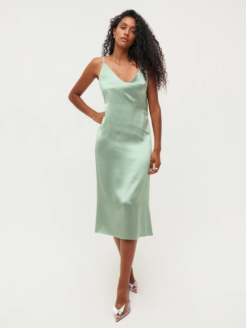 """This timeless slip dress doesn't scream """"bridesmaid"""" at all—so much so that it would work for a date—and we're here for it. $198, Reformation. <a href=""""https://www.thereformation.com/products/sofia-dress?color=Celadon"""" rel=""""nofollow noopener"""" target=""""_blank"""" data-ylk=""""slk:Get it now!"""" class=""""link rapid-noclick-resp"""">Get it now!</a>"""