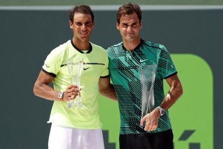 Apr 2, 2017; Key Biscayne, FL, USA; Rafael Nadal of Spain (L) and Roger Federer of Switzerland (R) hold the finalist and Butch Buchholz trophy, respectively, after their match in the men's singles championship of the 2017 Miami Open at Crandon Park Tennis Center. Mandatory Credit: Geoff Burke-USA TODAY Sports