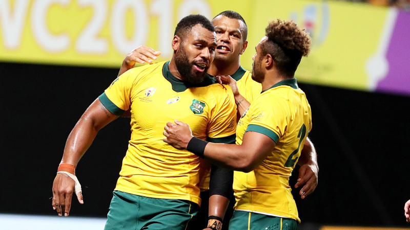 Samu Kerevi (L) of Australia celebrates scoring his side's fifth try during the Rugby World Cup 2019 Group D game between Australia and Fiji at Sapporo Dome. (Photo by Dan Mullan/Getty Images)