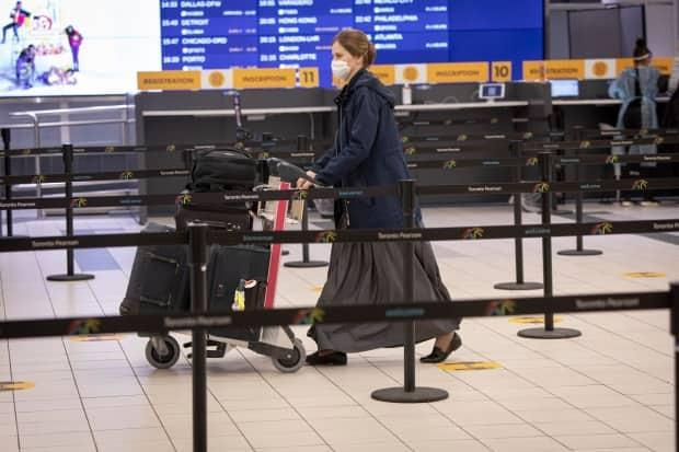 Passengers getting off international flights at Toronto's Pearson airport were among the first to get mandatory COVID-19 tests earlier this year. (Evan Mitsui/CBC - image credit)