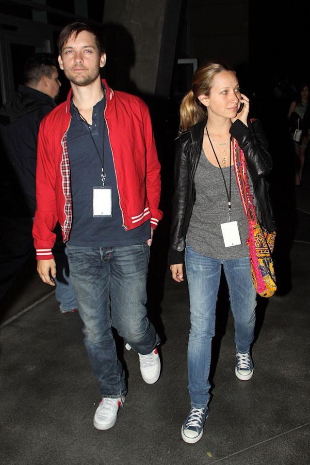 """Former """"Spider Man"""" star Tobey Maguire and his wife Jennifer Meyer got caught in the flashbulbs as they exited the Staples Center. David Tonnessen/<a href=""""http://www.pacificcoastnews.com/"""" target=""""new"""">PacificCoastNews.com</a> - March 26, 2010"""