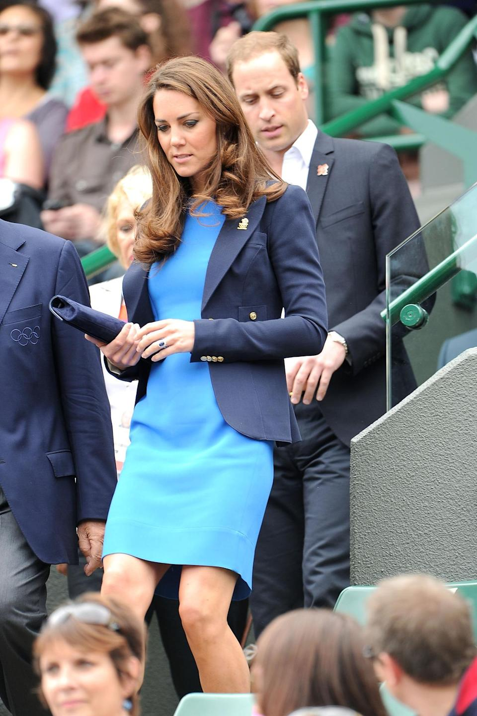 <p>Kate attended the Olympic tennis matches in a blue Stella McCartney dress, a suede Russell & Bromley clutch and a navy blazer from Smythe.</p><p><i>[Photo: Getty]</i></p>