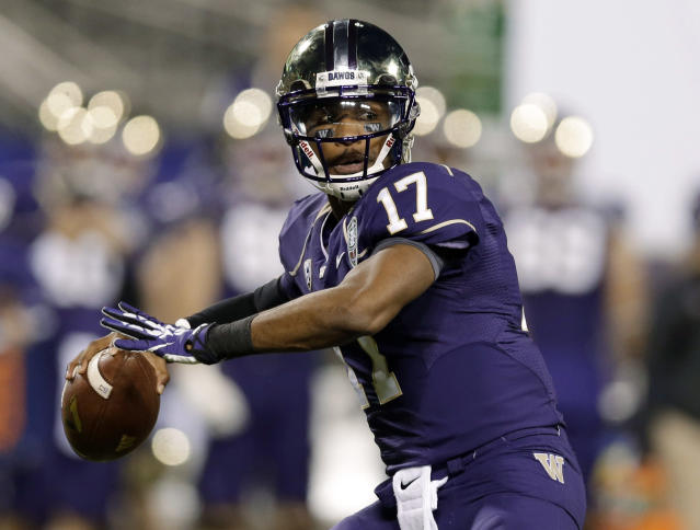 Washington quarterback Keith Price (17) throws against BYU during first half of the Fight Hunger Bowl NCAA college football game Friday, Dec. 27, 2013, in San Francisco. (AP Photo/Marcio Jose Sanchez)