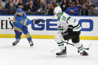 St. Louis Blues' Alex Pietrangelo (27) shoots past Dallas Stars' Jason Dickinson (18) during the second period of an NHL hockey game Saturday, Feb. 8, 2020, in St. Louis. (AP Photo/Jeff Roberson)