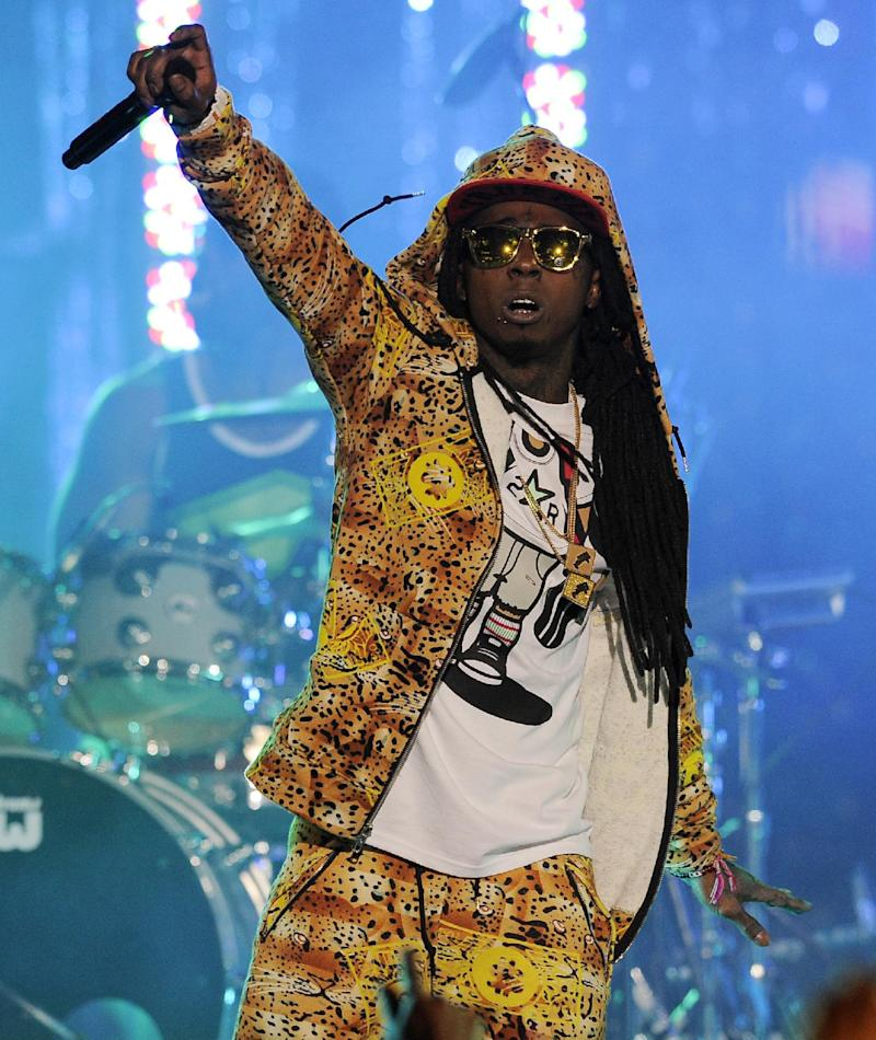 "FILE - In this March 1, 2012 file photo, Lil Wayne performs at the Caesars Entertainment ""Escape To Total Rewards"" concert, in Los Angeles. The multiplatinum rapper was hospitalized on Friday night, March 15, 2013, and reps confirmed he was ""recovering."" A person close to the superstar rapper's camp who asked for anonymity because of the sensitivity of the matter confirmed to The Associated Press that Lil Wayne had a seizure. (AP Photo/Chris Pizzello, File)"