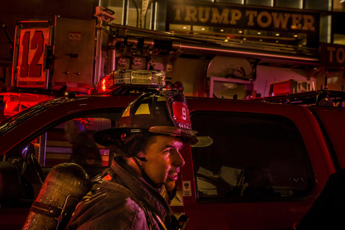 <p>A firefighter works in front of Trump Tower after a fire in New York, Saturday, April 7, 2018. (Photo: Andres Kudacki/AP) </p>