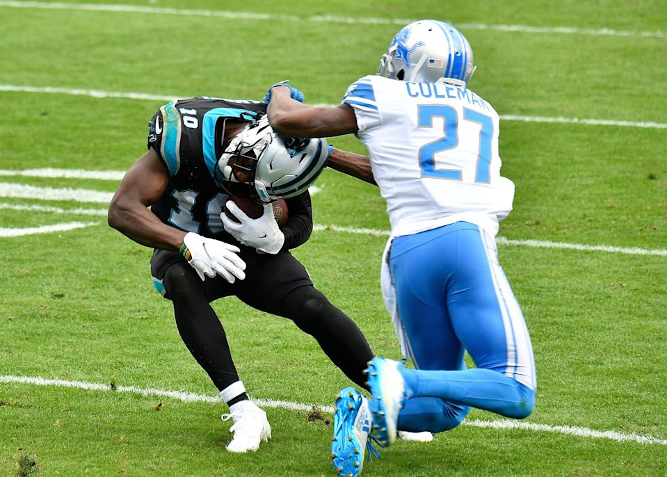 Panthers wide receiver Curtis Samuel attempts to break a tackle by Lions cornerback Justin Coleman during the first half on Sunday, Nov. 22, 2020, in Charlotte, North Carolina.