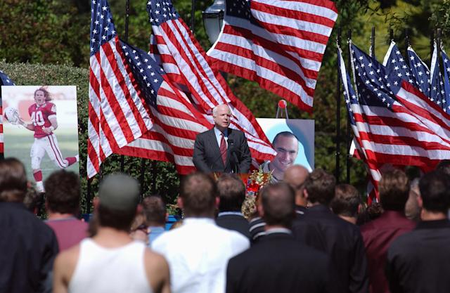 Senator John McCain (R-AZ) speaks at a memorial service held by the family of Cpl. Pat Tillman for Tillman, who was killed in action in Afghanistan April 22, 2004, at the San Jose Municipal Rose Garden May 3, 2004 in San Jose, California. Tillman turned down a lucrative NFL contract to serve with as a US Army Ranger. (Photo by David Paul Morris/Getty Images)
