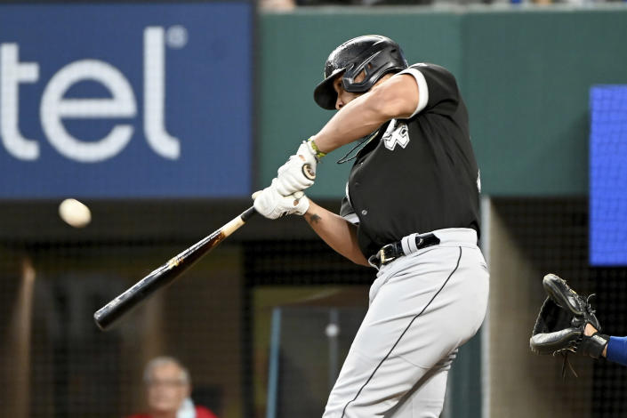 Chicago White Sox' Jose Abreu hits a two-run single in the fourth inning during a baseball game against the Texas Rangers in Arlington Texas, Sunday, Sept. 19, 2021. (AP Photo/Matt Strasen)