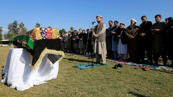 PHOTO: Afghan men pray near the coffin of journalist Malalai Maiwand, who was shot and killed by unknown gunmen in Jalalabad, Afghanistan, Dec. 10, 2020. (Parwiz/Reuters, FILE)