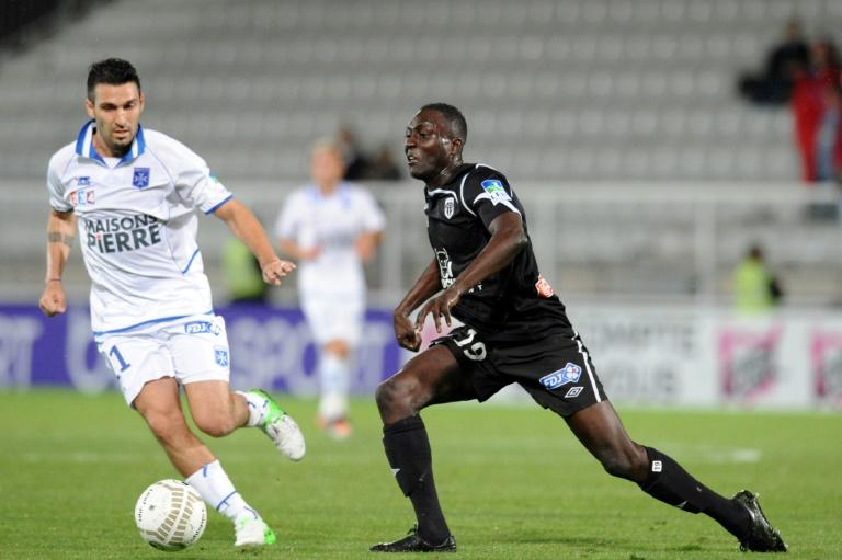 Defender Matar Fall (R, pictured September 2012) was fined 10,000 euros and banned for contributing to a loss by his team