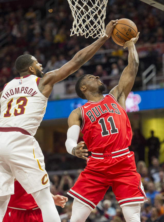 Cleveland Cavaliers' Tristan Thompson (13) blocks a shot by Chicago Bulls' David Nwaba (11) during the first half of an NBA preseason basketball game in Cleveland, Tuesday, Oct. 10, 2017. (AP Photo/Phil Long)