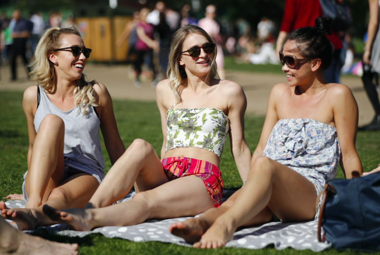 People enjoying the hot weather in Green Park in London at the weekend (Picture: Rex)