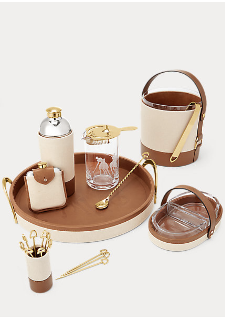 """<p><strong>Ralph Lauren Home</strong></p><p>ralphlauren.com</p><p><strong>$60.00</strong></p><p><a href=""""https://go.redirectingat.com?id=74968X1596630&url=https%3A%2F%2Fwww.ralphlauren.com%2Fhome-dining-barware%2Fgarrett-barware-collection%2F281982C.html&sref=https%3A%2F%2Fwww.elledecor.com%2Fshopping%2Fhome-accessories%2Fg31980395%2Fhome-shopper-guide-to-doing-good%2F"""" rel=""""nofollow noopener"""" target=""""_blank"""" data-ylk=""""slk:Shop Now"""" class=""""link rapid-noclick-resp"""">Shop Now</a></p><p>Re-create the Polo Bar in the comfort of your own home with this chic bar set by Ralph Lauren. The company has pledged $10 million to support COVID-19 relief, so you can feel better about your daily cocktail hour.</p>"""