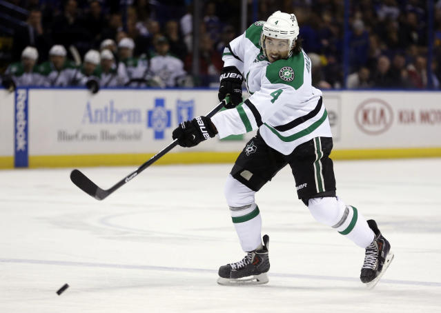 Dallas Stars' Brenden Dillon scores on a shot near the blue line during the first period of an NHL hockey game against the St. Louis Blues, Saturday, Nov. 23, 2013, in St. Louis. (AP Photo/Jeff Roberson)