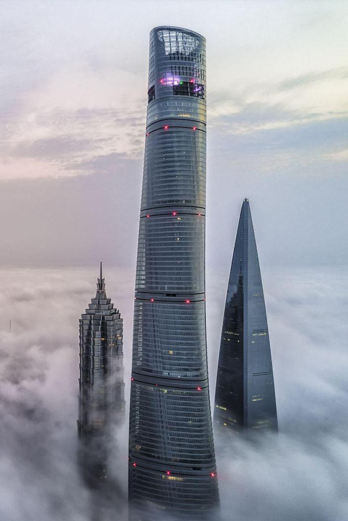<p><strong>Location: </strong>Shanghai, China</p><p><strong>Height: </strong>2,073</p><p><strong>Completion date: </strong>2014</p><p>Twisting to the sky with 128 floors that make the Shanghai Tower one of the tallest in the world, the design from Gensler embraces an inner glass façade and a twirling exterior. While inside the tower features nine zones created by the stacking of interior components atop one another, the curved exterior not only provides a unique aesthetic as the third of three skyscrapers in close proximity, but also offers an engineering benefit by reducing wind loads. </p><p>With one of the world's highest observation decks opened to the public in 2016, inside expect a mix of uses and plenty of singular views of the city. </p>