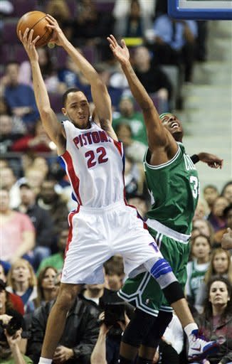 Detroit Pistons' Tayshaun Prince (22) grabs a rebound away from Boston Celtics' Paul Pierce in the first half of an NBA basketball game, Sunday, Feb. 19, 2012, in Auburn Hills, Mich. (AP Photo/Duane Burleson)