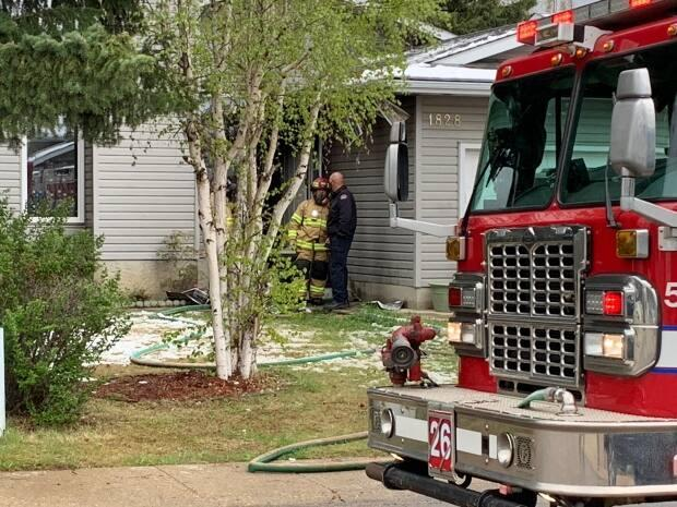 Fire at 18th Avenue and 35th Street was deemed under control at 5 p.m. Wednesday.  (Scott Neufeld/CBC - image credit)