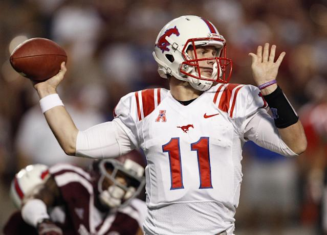 SMU quarterback Garrett Gilbert (11) looks for a receiver during the second quarter of an NCAA college football game against Texas A&M Saturday, Sept. 21, 2013, in College Station, Texas. (AP Photo/Bob Levey)