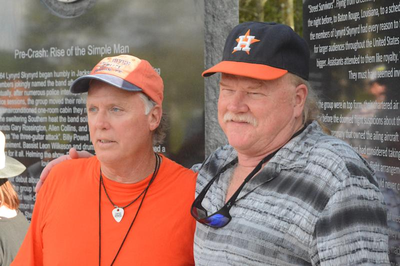 Lynyrd Skynyrd plane crash survivors Mark Howard, left, and Steve Lawler stand in front of a monument dedicated to those who died in the Oct. 20, 1977. The two were at the unveiling ceremony 42 years later, on Oct. 20, 2019.