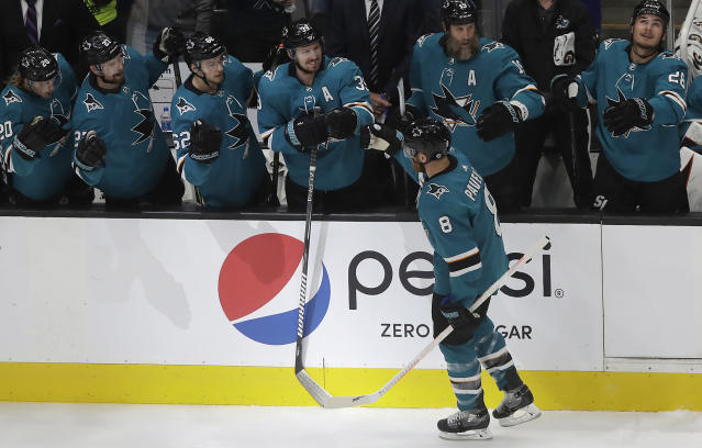 San Jose Sharks center Joe Pavelski (8) is congratulated by teammates after scoring a goal against the Colorado Avalanche during the first period of Game 7 of an NHL hockey second-round playoff series in San Jose, Calif., Wednesday, May 8, 2019. (AP Photo/Jeff Chiu)