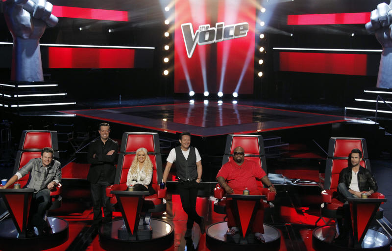 "FILE - In this Oct. 28, 2011 file photo, from left, judge Blake Shelton, host Carson Daly, judge Christina Aguilera, producer Mark Burnett, judge Cee Lo Green, and judge Adam Levine, from the ""The Voice"", pose for photographers in Culver City, Calif. The season two winner of the singing competition series will be revealed on Tuesday, May 8, on a live finale airing at 9:00 p.m. EST on NBC. (AP Photo/Matt Sayles, file)"